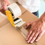 Man taping packing case